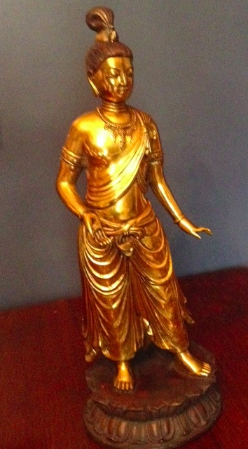 Standing Buddha in lacquered bronze.