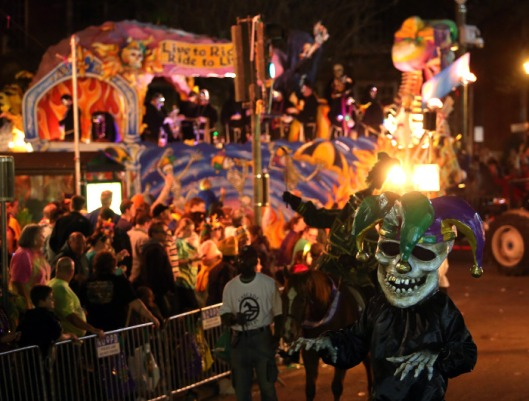 "The 460 riders of the satirical Krewe D'Etat turn onto St. Charles Avenue as they roll down the traditional Uptown route with their 22-float presentation entitled ""The Dictator's Reading Room"" Friday, Feb. 8, 2013 in New Orleans. (AP Photo/The Times-Picayune, Michael DeMocker) MAGS OUT; NO SALES; USA TODAY OUT; THE BATON ROUGE ADVOCATE OUT"