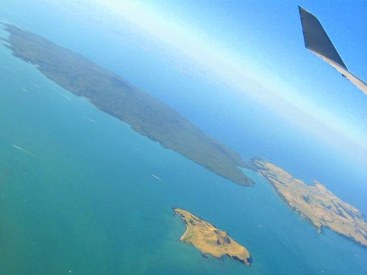 Rangitoto Island (LHS) and its built causeway to Motutapu Island visible in the background of Browns Island.