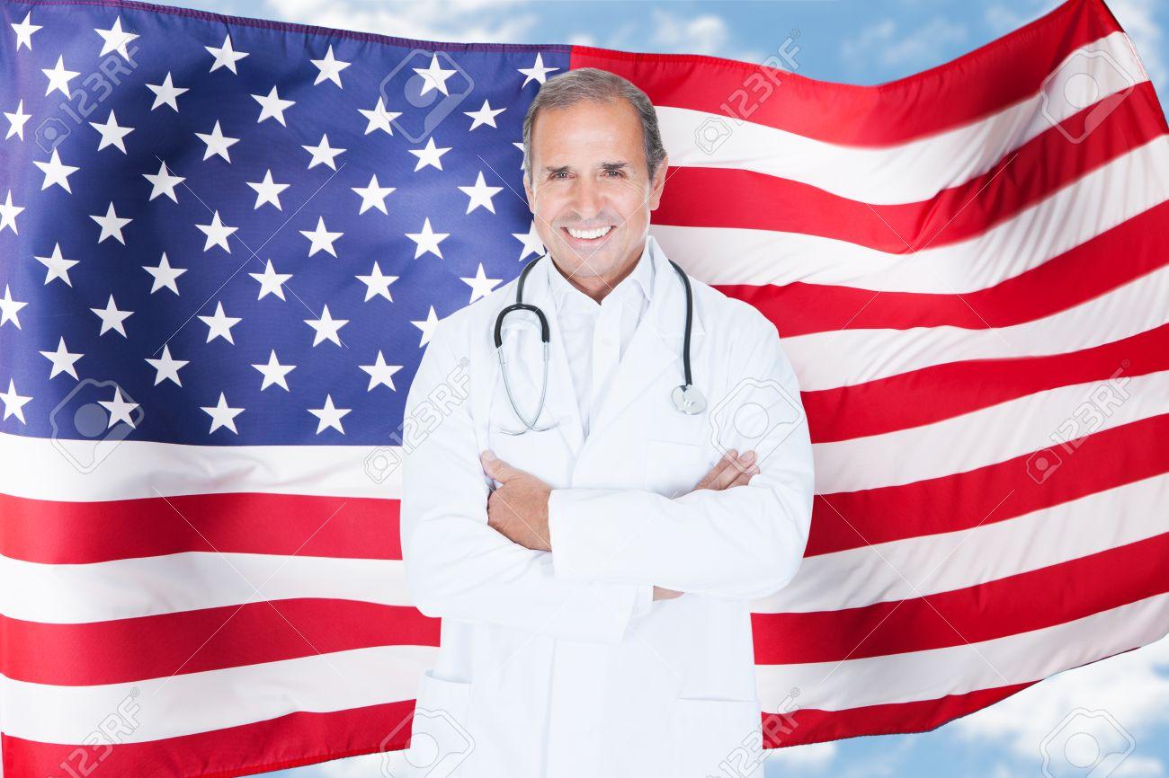 Portrait Of Happy Mature Male Doctor