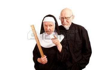6459934-funny-priest-with-mean-nun-holding-ruler