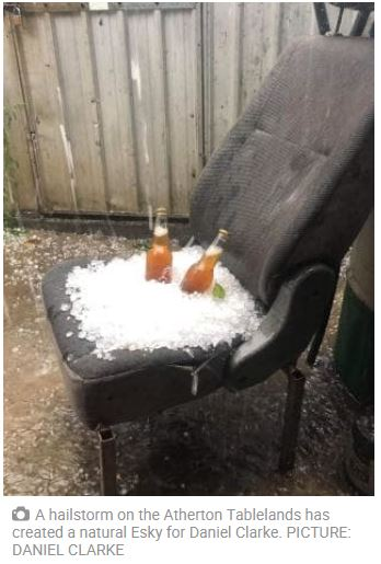 Old Car seat that was outside in a storm, collected a pile of hail and somebody put a couple of bottles of beer in hail - as a makeshift Esky.
